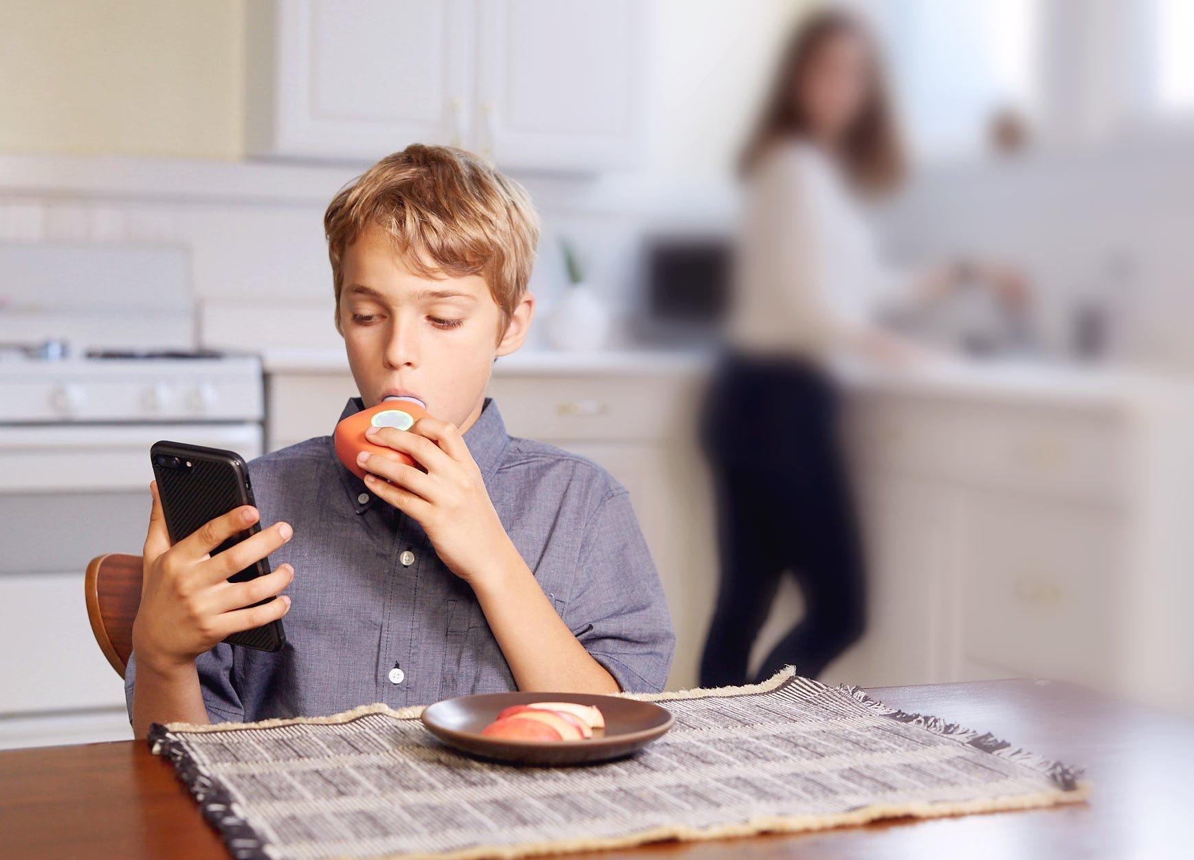boy using Aluna portable spirometer