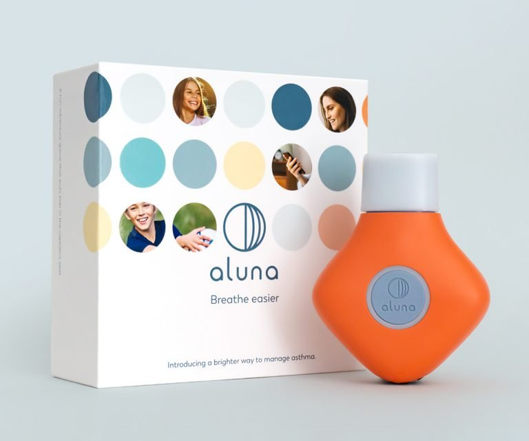 orange aluna spirometer and packaging box with logo and tagline, breathe easier