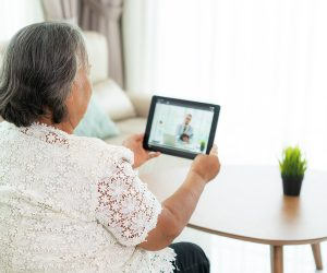 woman speaking to doctor on tablet