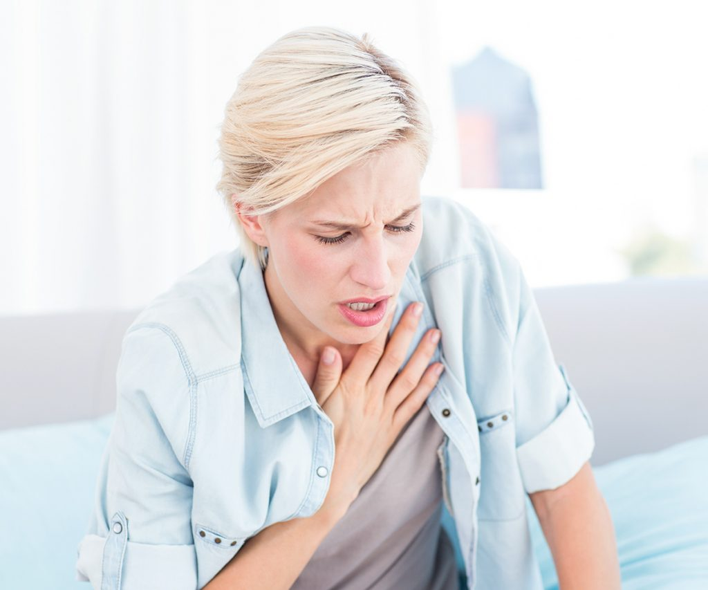 exhausted woman holding her chest