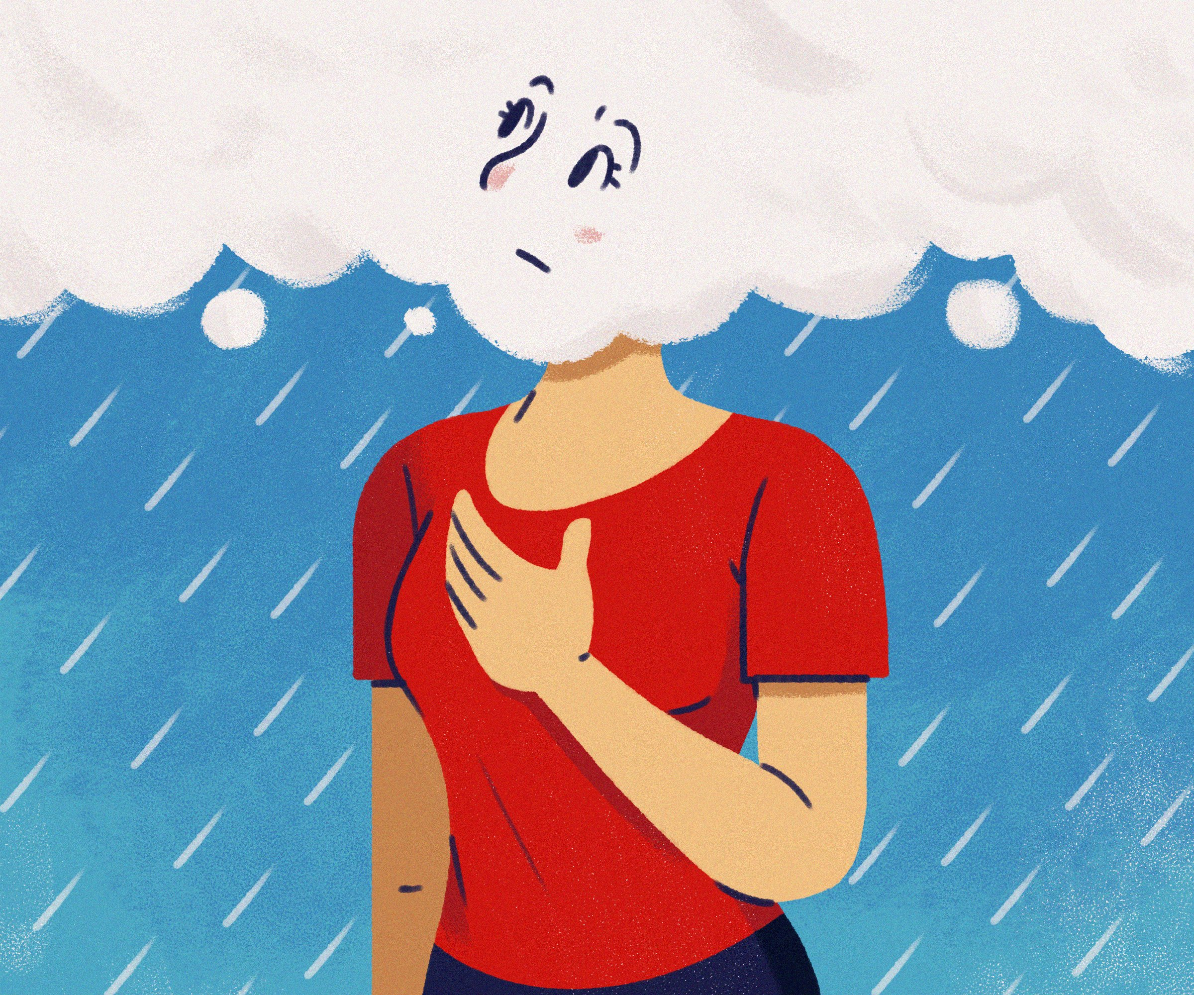 concerned woman looks at rain clouds